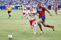 FC Barcelona forward Thierry Henry (14) and New York Red Bulls defender Chris Leitch (33). FC Barcelona defeated the New York Red Bulls 6-2 during an international friendly at Giants Stadium in East Rutherford, NJ, on August 6, 2008.