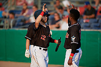 Batavia Muckdogs J.D. Orr (22) high fives Dalvy Rosario (17) during a NY-Penn League game against the Lowell Spinners on July 10, 2019 at Dwyer Stadium in Batavia, New York.  Batavia defeated Lowell 8-6.  (Mike Janes/Four Seam Images)