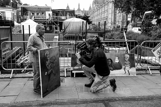 """Kaya Mar (Painter and political caricaturist - For more information about the Artist please click here:  http://www.kayamarart.com/ ). <br /> <br /> London, March-July 2016. Reporting the EU Referendum 2016 (Campaign, result and outcomes) observed through the eyes (and the lenses) of an Italian freelance photojournalist (UK and IFJ Press Cards holder) based in the British Capital with no """"press accreditation"""" and no timetable of the main political parties' events in support of the RemaIN Campaign or the Leave the EU Campaign.<br /> On the 23rd of June 2016 the British people voted in the EU Referendum... (Please find the caption on PDF at the beginning of the Reportage).<br /> <br /> For more information about the result please click here: http://www.bbc.co.uk/news/politics/eu_referendum/results"""