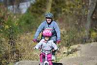 Amanda Seliger of Centerton rides with her daughter Everly  Seliger, 4, Sunday, November 15, 2020 along the Mama Bear trail in Bentonville. Check out nwaonline.com/201116Daily/ for today's photo gallery. <br /> (NWA Democrat-Gazette/Charlie Kaijo)