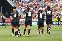 14 MAY 2011:USA Women's National Team midfielder Heather O'Reilly (9), midfielder Carli Lloyd (10), forward Amy Rodriguez (8), forward Abby Wambach (20)  during the International Friendly soccer match between Japan WNT vs USA WNT at Crew Stadium in Columbus, Ohio.
