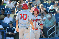 Matt Whatley (40) of the Spokane Indians greets teammate Kole Enright (10) after his home run during a game against the Hillsboro Hops at Ron Tonkin Field on July 22, 2017 in Hillsboro, Oregon. Spokane defeated Hillsboro, 11-4. (Larry Goren/Four Seam Images)