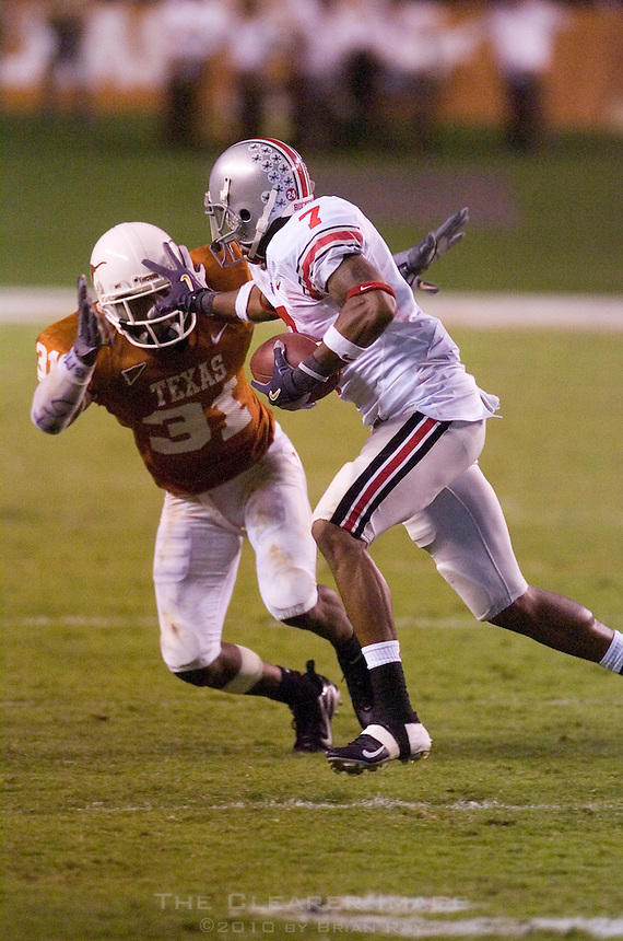 09 September 2006: Ohio State receiver and Heisman candidate Ted Ginn Jr. stiff arms Texas defender Aaron Ross during the Buckeyes 24-7 victory over the Longhorns at Darrell K Royal Memorial Stadium in Austin, TX.