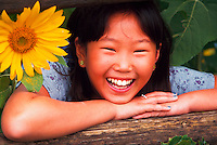 Teen girl with sunflower.