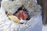 Saturday March 10, 2012  Nicholas Petit all bundled up into a tunnel in Galena. Iditarod 2012.