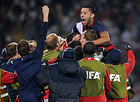 Clint Dempsey of USA celebrates his goal with teammates. USA vs England in the 2010 FIFA World Cup at Royal Bafokeng Stadium in Rustenburg, South Africa on June 12, 2010.