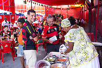 Fans buy street food from a bar near to Arena Fonte Nova