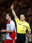 St Johnstone v Inverness Caley Thistle....02.01.11  .Lee Cox is booked by ref George Salmond.Picture by Graeme Hart..Copyright Perthshire Picture Agency.Tel: 01738 623350  Mobile: 07990 594431