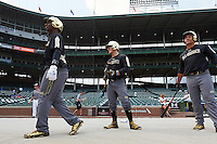 Christian Jones (left) of Federal Way Senior High School in Federal Way, Washington, Thomas Dillard (center) of Oxford High School in Greenwood, Mississippi and Keenan Bell (right) of Episcopal High School in Jacksonville, Florida during batting practice before the Under Armour All-American Game on August 15, 2015 at Wrigley Field in Chicago, Illinois. (Mike Janes/Four Seam Images)