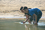 Two boys collect water from the Sangu River at Bandarban