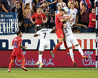 KANSAS CITY, KS - JUNE 26: Gyasi Zardes #9 heads the ball over Harold Cummings #3 as Jose Rodriguez #7 and Cristian Roldan #15 look on during a game between Panama and USMNT at Children's Mercy Park on June 26, 2019 in Kansas City, Kansas.