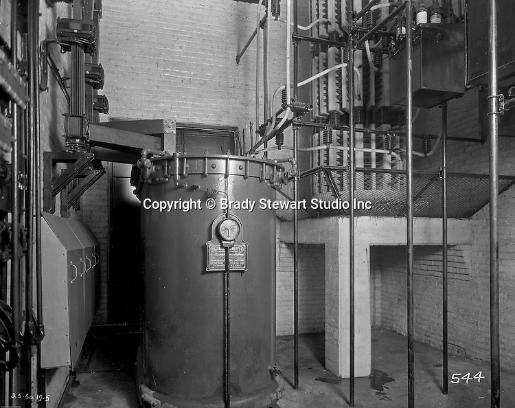 Client: Swindell Dressler Corporation<br /> Ad Agency: George Ketchum Advertising<br /> Contact: George Ketchum<br /> Product: General Electric transformer<br /> Location: Swindell Dressler factory in Pittsburgh <br /> <br /> View of a General Electric transformer driving the Swindell-Dressler Electric Furnace and other Equipment.  Swindell Dressler International Company was based in Pittsburgh, Pennsylvania. The company was founded by Phillip Dressler in 1915 as American Dressler Tunnel Kilns, Inc.  In 1930, American Dressler Tunnel Kilns, Inc. merged with William Swindell and Brothers to form Swindell-Dressler Corporation. The Swindell brothers designed, built, and repaired metallurgical furnaces for the steel and aluminum industries. The new company offered extensive heat-treating capabilities to heavy industry worldwide.