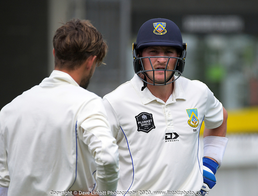 Nathan Smith (right) prepares to return to the crease after tea during day one of the Plunket Shield match between the Wellington Firebirds and Otago at Basin Reserve in Wellington, New Zealand on Thursday, 5 November 2020. Photo: Dave Lintott / lintottphoto.co.nz