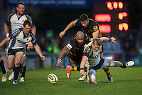 Jake Abbott of Worcester Warriors (right) loses the ball as he is tackled by Tom Lindsay (rear) and Tom Varndell of London Wasps during the LV= Cup second round match between London Wasps and Worcester Warriors at Adams Park on Sunday 18th November 2012 (Photo by Rob Munro)
