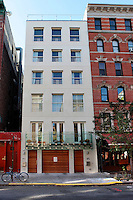 stucco townhouse..Sue Hostetler is the editor in chief for an art magazine. The house is located in the East Village in New York city - a neighborhood historically known for its funky, artistic and independent vibe.  It is a 6 story, stucco townhouse .