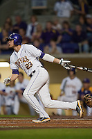 LSU Tigers second baseman JaCoby Jones #23 follows through with an RBI double in the first inning against the Mississippi State Bulldogs during the NCAA baseball game on March 16, 2012 at Alex Box Stadium in Baton Rouge, Louisiana. LSU defeated Mississippi State 3-2 in 10 innings. (Andrew Woolley / Four Seam Images).
