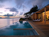 A decked sun terrace leads to an infinity pool overlooking the Indian Ocean at the Zamani Hotel in Zanzibar