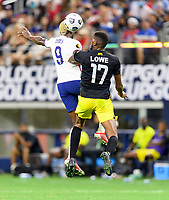 DALLAS, TX - JULY 25: Gyasi Zardes #9 of the United States heads the ball over Damion Lowe #17 of Jamaica during a game between Jamaica and USMNT at AT&T Stadium on July 25, 2021 in Dallas, Texas.