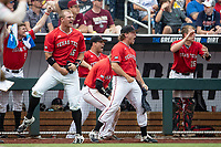 Texas Tech Red Raiders shortstop Josh Jung (16) celebrates taking the lead during Game 5 of the NCAA College World Series against the Arkansas Razorbacks on June 17, 2019 at TD Ameritrade Park in Omaha, Nebraska. Texas Tech defeated Arkansas 5-4. (Andrew Woolley/Four Seam Images)