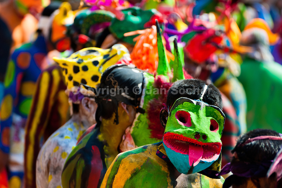 """Cora Indians, wearing colorful demon masks, run during the sacred ritual ceremony of Semana Santa (Holy Week) in Jesús María, Nayarit, Mexico, 22 April 2011. The annual week-long Easter festivity (called """"La Judea""""), performed in the rugged mountain country of Sierra del Nayar, merges indigenous tradition (agricultural cycle and the regeneration of life worshipping) and animistic beliefs with the Christian dogma. Each year in the spring, the Cora villages are taken over by hundreds of wildly running men. Painted all over their semi-naked bodies, fighting ritual battles with wooden swords and dancing crazily, they perform demons (the evil) that metaphorically chase Jesus Christ, kill him, but finally fail due to his resurrection. La Judea, the Holy Week sacred spectacle, represents the most truthful expression of the Coras' culture, religiosity and identity."""