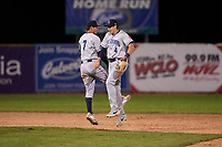 Lake County Captains Tyler Freeman (7) and Ruben Cardenas (4) celebrate a victory after a Midwest League game against the Beloit Snappers at Pohlman Field on May 6, 2019 in Beloit, Wisconsin. Lake County defeated Beloit 9-1. (Zachary Lucy/Four Seam Images)
