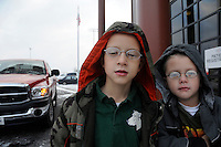 Seven year old Matthew and five year old Joshua Petty wearing their first pairs of glasses. Over the weekend at Soft Shell, Knott County, in the Appalachian mountains of eastern Kentucky, the congressional district with the nation's lowest life expectancy, RAM volunteers saw 822 needy people. 95 percent of people seen were provided with dental or optical care. RAM was founded in 1985 to provide free health, dental and eye care in the developing world. However, RAM now provides 60 percent of its services in the US, providing for the estimated 47 million Americans without health insurance..