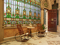 A magnificent stained glass window in the Inner Garden brings natural forms inside, with its colourful glass foliage echoing the floral motifs of the mosaic-tiled floor