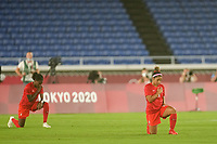 YOKOHAMA, JAPAN - AUGUST 6: Desiree Scott #11 of Canada take a knee before the start of the match during a game between Canada and Sweden at International Stadium Yokohama on August 6, 2021 in Yokohama, Japan.