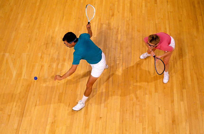 Man and women playing racquetball.