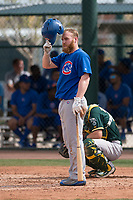 Chicago Cubs third baseman Jesse Hodges (19) steps out of the batter's box during a Minor League Spring Training game against the Oakland Athletics at Sloan Park on March 13, 2018 in Mesa, Arizona. (Zachary Lucy/Four Seam Images)