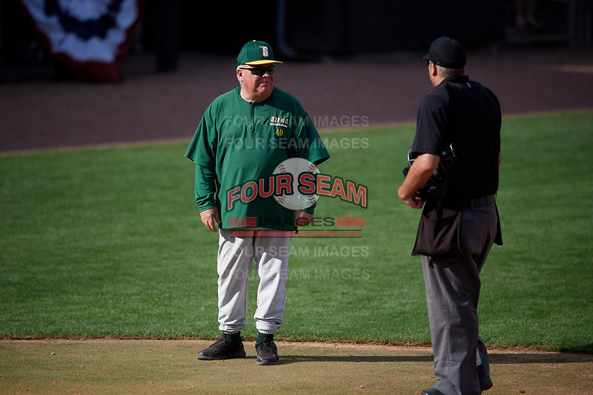 Siena Saints head coach Tony Rossi (40) talks with home plate umpire John Bennett during a game against the UCF Knights on February 17, 2019 at John Euliano Park in Orlando, Florida.  UCF defeated Siena 7-1.  (Mike Janes/Four Seam Images)