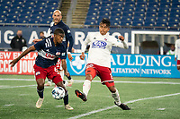 FOXBOROUGH, MA - OCTOBER 16: Dominick Hernandez #15 of North Texas SC passes the ball as Maciel #6 of New England Revolution II pressures during a game between North Texas SC and New England Revolution II at Gillette Stadium on October 16, 2020 in Foxborough, Massachusetts.