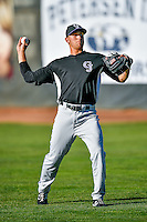 Grand Junction Rockies starting pitcher Mike Nikorak (14) warms up in the outfield before the game against the Ogden Raptors in Pioneer League action at Lindquist Field on June 20, 2016 in Ogden, Utah. The Rockies defeated the Raptors 5-2. (Stephen Smith/Four Seam Images)