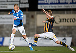 Kenny Miller avoids the tackle from Stevie Campbell