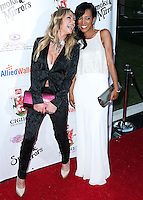 BEVERLY HILLS, CA, USA - SEPTEMBER 13: Taylor Armstrong and Shaun Robinson arrive at the Brent Shapiro Foundation For Alcohol And Drug Awareness' Annual 'Summer Spectacular Under The Stars' 2014 held at a Private Residence on September 13, 2014 in Beverly Hills, California, United States. (Photo by Xavier Collin/Celebrity Monitor)