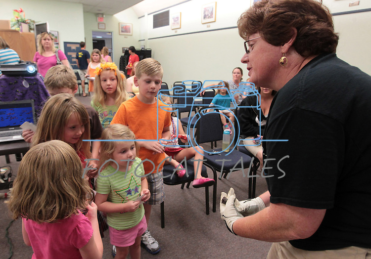 Corky Quirk, of NorCal Bats, teaches kids about bats at the Carson City Library on Saturday, July 7, 2012..Photo by Cathleen Allison