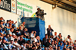 A TV camera in the East Stand. The game was shown live on BBC Scotland. Kilmarnock 2 Ayr United 0, Scottish Championship, August 2nd 2021. Following Kilmarnock's relegation in 2020-21, the first game of the new season is the Ayreshire Derby, the first league match between the teams in 28 years. Due to relaxation of Covid restrictions the match was played in front of a crowd of 3200 Kilmarnock fans. The game was shown live on BBC Scotland.