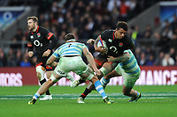 Courtney Lawes of England is tackled by Marcos Kremer of Argentina during the Old Mutual Wealth Series match between England and Argentina at Twickenham Stadium on Saturday 11th November 2017 (Photo by Rob Munro/Stewart Communications)