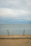 Surf Club Beach, Madison, CT. View of Long Island Sound from park steps to beach.