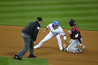 Ki Hyuk Park of Korea is late on the tag of Yasuyuki Kataoka of Japan at second base during the World Baseball Classic at Dodger Stadium on March 23, 2009 in Los Angeles, California. (Larry Goren/Four Seam Images)