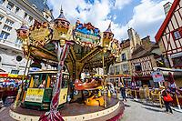 France, Burgundy, Bourgogne, Dijon. European Waterways wine barge cruising. Market in Dijon. Carousel in city center.