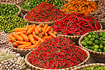 The smaller the chile, the hotter it is! Orange and red chiles are on display along with plump carrots, fragrant lemongrass, green limes and zesty ginger root. Markets are always the most colorful places to photograph in Hanoi, Vietnam.