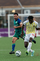 HARTFORD, CT - AUGUST 17: Temi Adesodun #15 of Charleston Battery passes the ball during a game between Charleston Battery and Hartford Athletic at Dillon Stadium on August 17, 2021 in Hartford, Connecticut.