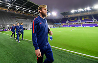 ORLANDO, FL - NOVEMBER 15: Tim Ream #13 of the United States walks onto the field during a game between Canada and USMNT at Exploria Stadium on November 15, 2019 in Orlando, Florida.