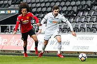 Sunday 18 March 2018<br /> Pictured:  Matic Paljk of Swansea City is challenged by Tahith Chong of Manchester United<br /> Re: Swansea City v Manchester United U23s in the Premier League 2 at The Liberty Stadium on March 18, 2018 in Swansea, Wales.