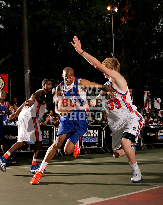 Anthony Randolph (4) drives to the basket with defense by Kyle Singler (33) during the Elite 24 Hoops Classic game on September 1, 2006 held at Rucker Park in New York, New York.  The game brought together the top 24 high school basketball players in the country regardless of class or sneaker affiliation.