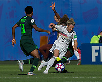 GRENOBLE, FRANCE - JUNE 22: Svenja Huth #9 of the German National Team dribbles as Francisca Ordega #17 of the Nigerian National Team successfully defends during a game between Panama and Guyana at Stade des Alpes on June 22, 2019 in Grenoble, France.