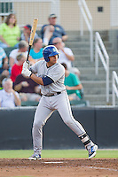 Jose Briceno (4) of the Asheville Tourists at bat against the Kannapolis Intimidators at CMC-NorthEast Stadium on July 12, 2014 in Kannapolis, North Carolina.  The Tourists defeated the Intimidators 7-5 in 15 innings.  (Brian Westerholt/Four Seam Images)