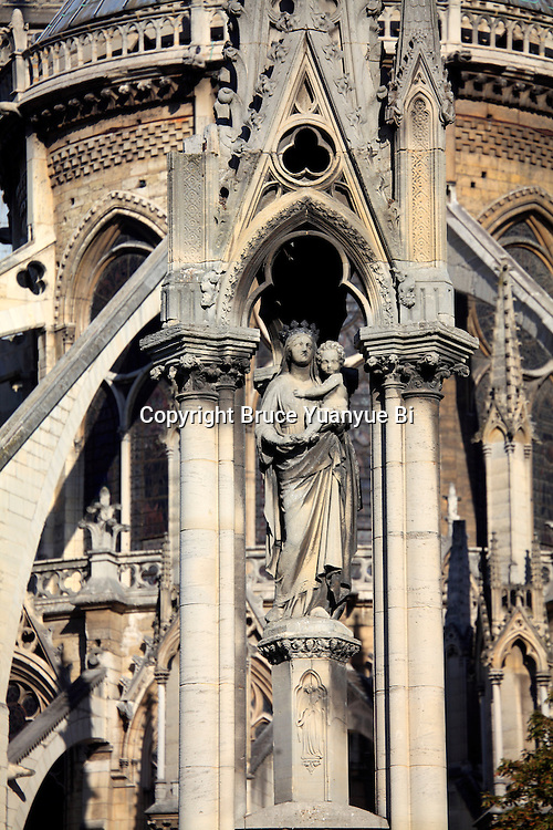 A closed up view of Fountain of the Virgin in Square Jean XXIII with the flying buttresses of Norte Dame cathedral in the background. city of Paris. Paris. France