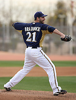 Zach Braddock #21 of the Milwaukee Brewers participates in pitchers fielding practice during spring training workouts at the Brewers complex on February 18, 2011  in Phoenix, Arizona. .Photo by Bill Mitchell / Four Seam Images.